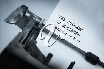 Vintage typewriter, old rusty, warm yellow filter - The succes of business, chapter 2