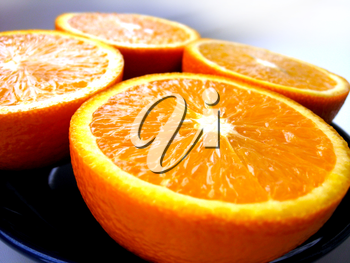 Four fractions of the cut orange on a plate