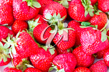 Photo of the background fresh red strawberries