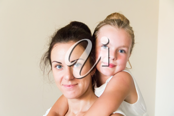 Photo of mother and daughter in white