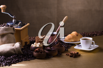 Still-life with coffee, cup with saucer, coffee beans and spices.