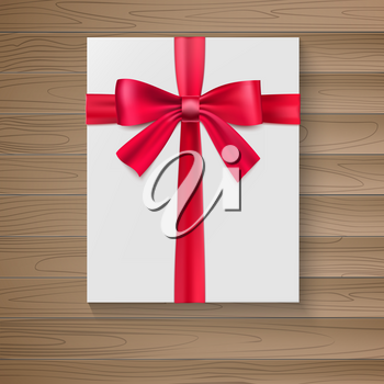 White package with a large red bow. A holiday gift box close-up, top view on wooden background. Vector white square gift box with shiny red satin bow, ribbon.