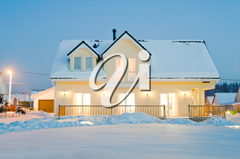 evening country house with electric light in winter