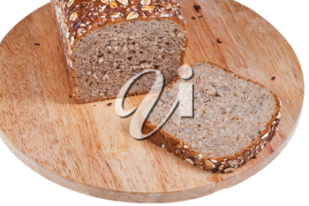 loaf of rye grain bread and sliced piece on wooden board on white background