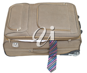 ajar textile suitcase with male tie isolated on white background