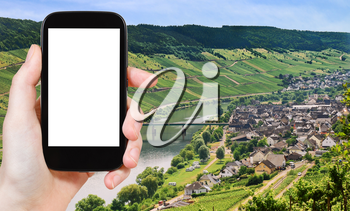 travel concept - tourist photograph Town Zell and Moselle river, Germany in summer day on tablet pc with cut out screen with blank place for advertising logo