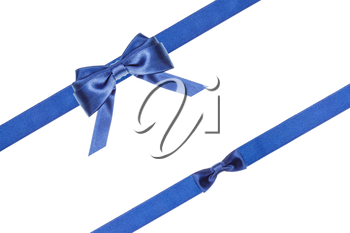 blue satin bow and knot and two diagonal ribbons isolated on horizontal white background