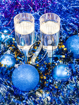 Christmas still life - above view of two glasses of sparkling wine in blue Xmas decorations