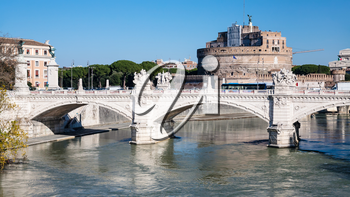 Travel to Italy - view of Ponte (bridge) Vittorio Emanuele II on Tiber river and Castle of Holy Angel in Rome city in sunny winter day