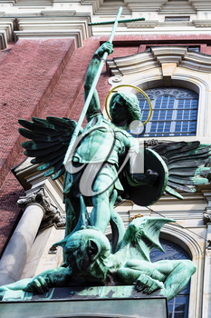 Travel to Germany - Victory of St Michael over the Devil, figure above the entrance of St Michael's church (Hauptkirche Sankt Michaelis) in Hamburg city