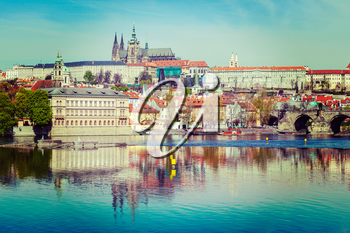 Vintage retro hipster style travel image of  Charles bridge over Vltava river and Gradchany Prague Castle and St. Vitus Cathedral