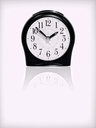 Alarm clock with reflection on white background.Purple toned image.