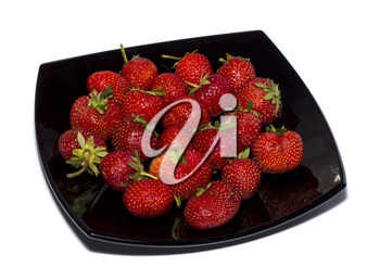 strawberry on a black plate a side view