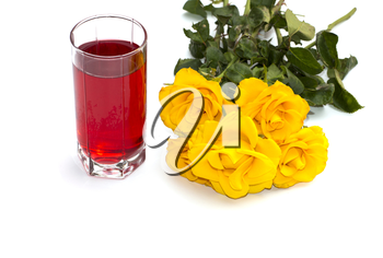 glass of red juice and bouquet of bright yellow roses at the left, isolate, still life, subject beautiful flowers and drinks