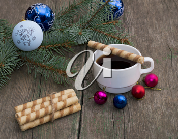 coniferous branch with an ornament, coffee and baking, the subject Christmas and New Year