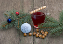 coniferous branch with Christmas tree decorations, tea and nutlets, the subject Christmas and New Year