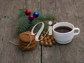 coffee, fir-tree branch, linking of oatmeal cookies and forest nutlets, subject holidays Christmas and New Year
