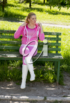 the woman in a pink suit on a bench in park, a subject nature seasons, spring and beautiful women