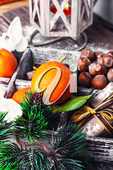 Decorative wooden box with hazelnuts,mandarins and gifts.