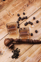 Smoking pipe in a retro style,dark chocolate and glasses of whiskey on wooden background