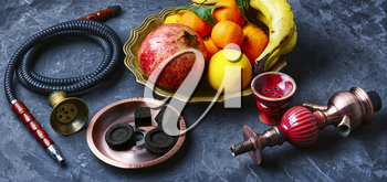 banner with smoking hookah and dish with tangerines,pomegranate and banana