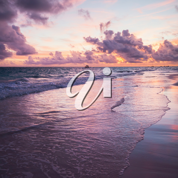 Colorful sunrise over Atlantic Ocean coast, Bavaro beach, Hispaniola Island. Dominican Republic, coastal landscape. Square photo
