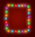 Multicolored glassy led Christmas lights garland like frame on red background