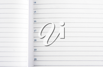 Close-up view of an open business diary