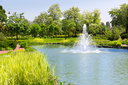 Beautiful lake in spring park with fountain