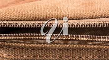 Macro view of brown bag with open zipper