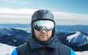 Mountain-skier against mountain with reflection in googles