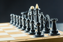 Black chess figures on the board ready to fight