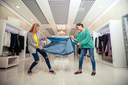 Young women fighting for a jacket in the shop