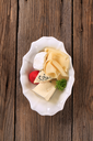 Assorted cheeses in a bowl
