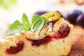 Slice of plum cake with crumb topping