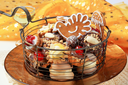 Assorted dessert cookies in a wire basket