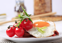 Vegetarian dish of red bean and tomato salad and fried egg
