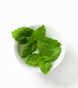 Fresh mint leaves in a cup