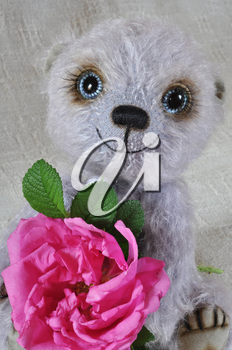 Handmade, the sewed toy: teddy-bear Chupa with a dogrose flower