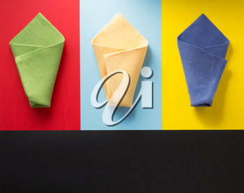 folded napkin at abstract colorful background