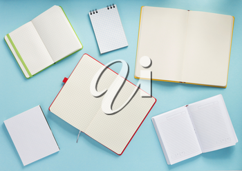 open notebook at abstract background surface