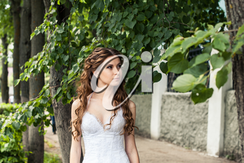 Photo of the girl in a wedding dress on the street.