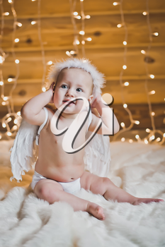 The child with white wings.