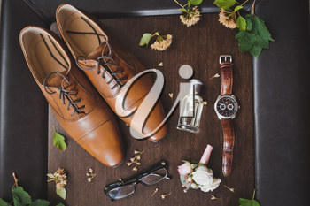 Men glasses watches and perfume with a boots.