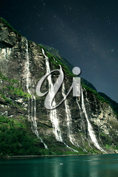 At night, under the light of stars. Geiranger fjord, Norway - waterfalls Seven Sisters.