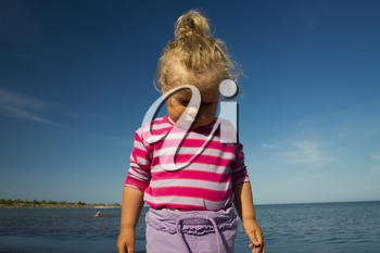 little girl weeping by the sea. summer vacation by the ocean