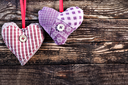 color hearts from textile on wooden background