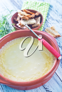 cheese fondue and dry bread on a table