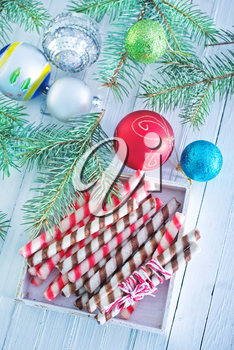 Christmas candy, Christmas treats and a branch of the Christmas tree