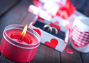 present for valentines day in the box and candle on a table